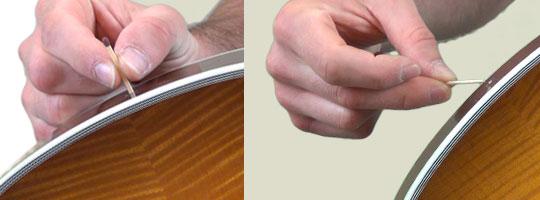 Allumette ou cure-dent pour réparer l'attache-courroie sur une guitare